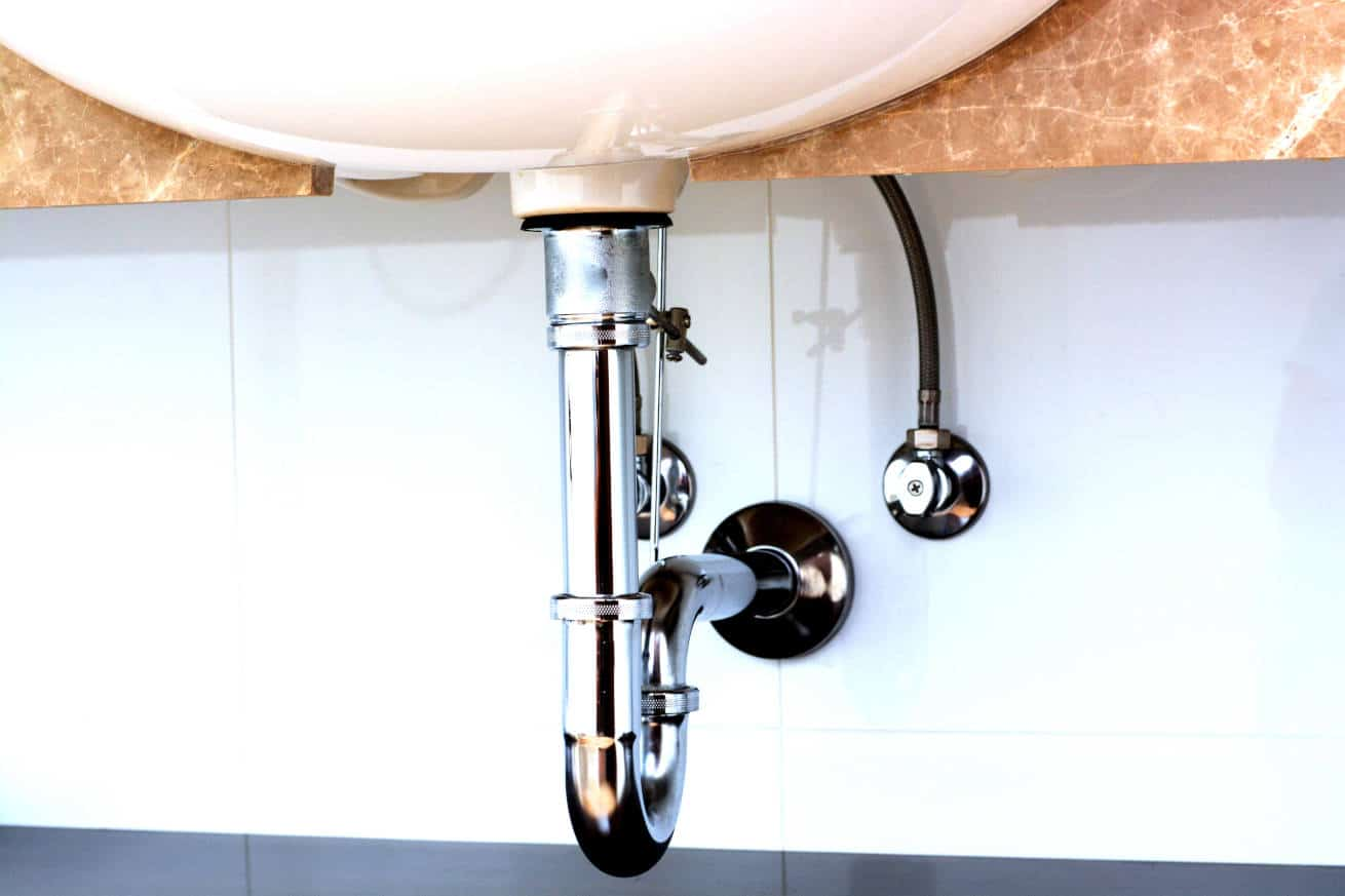 A P pipe drain underneath a standalone sink