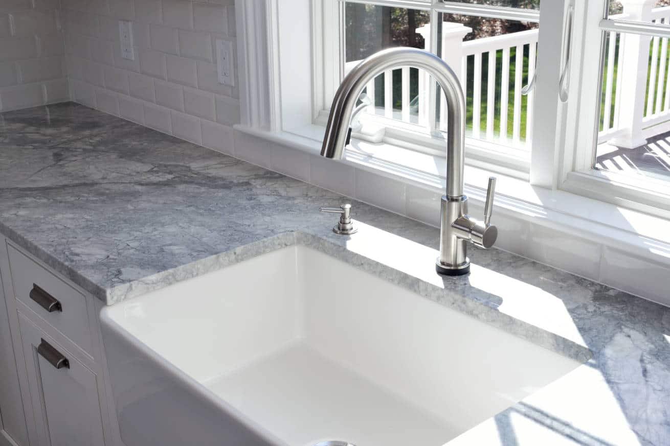 A kitchen faucet over a farmhouse sink