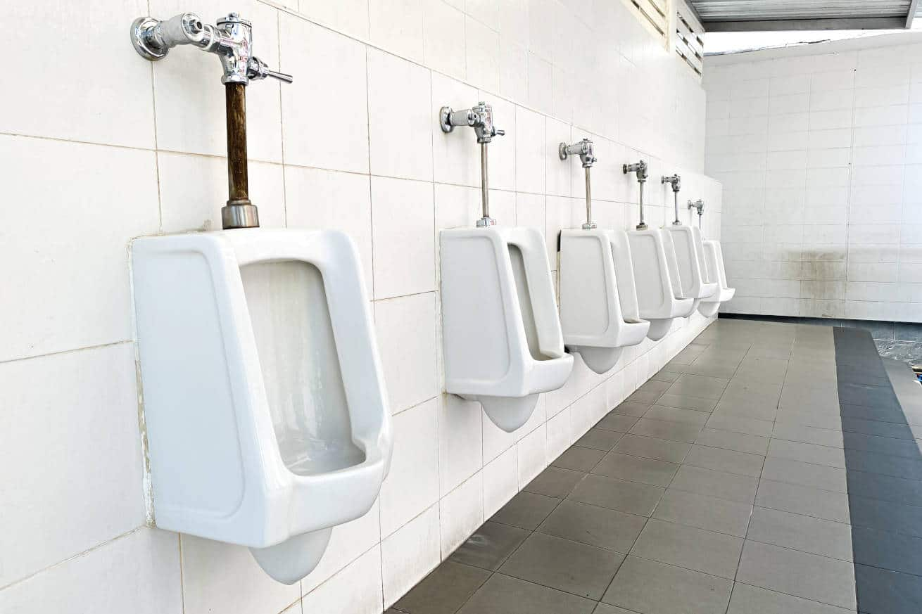A line of urinals in a public restroom