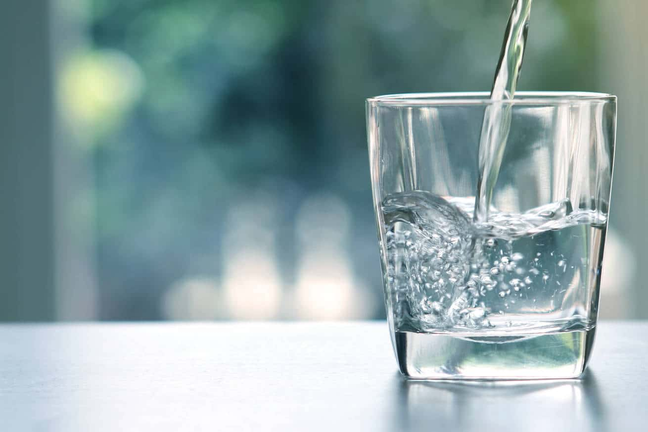 Clear pure water poured into a clean glass